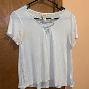 White t-shirt with crossed lace across top.